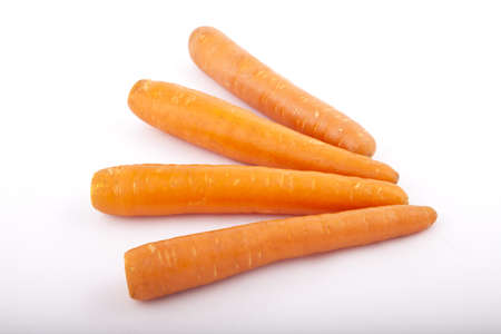 four carrots on a white background