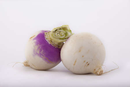 two turnips on a white background