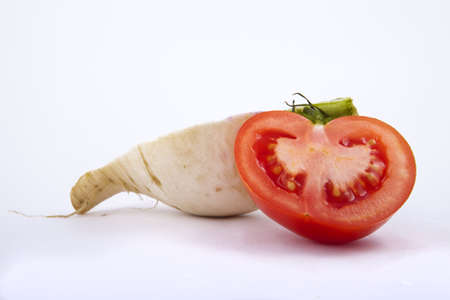 tomato and turnip on white background