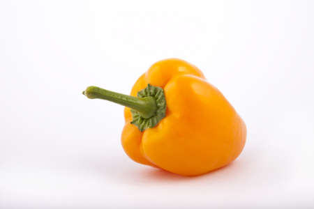 orange peppers on a white background photo