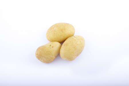 three potato on a white background