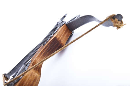 crossbow with an arrow on a white background Imagens