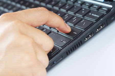 A finger press enter button on keyboard Stock Photo - 9453264