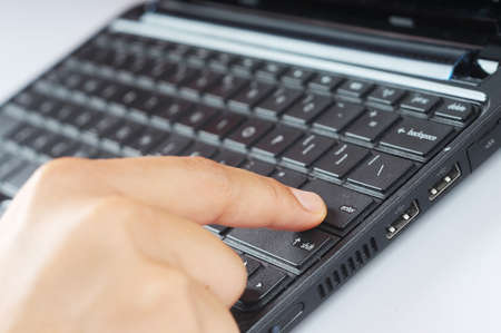 A finger press enter button isolated with keyboard background Stock Photo - 9453265