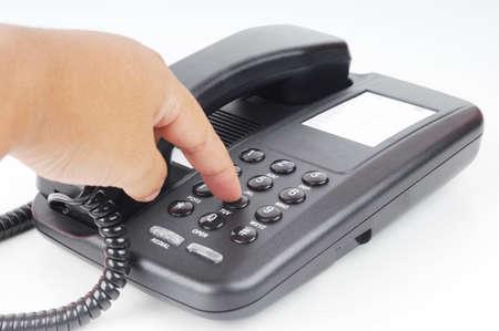 dialing: Una mano marcando el n�mero de tel�fono aislada con fondo blanco