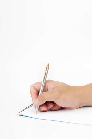 A hand holding a pen to write on a notepad isolated with white background
