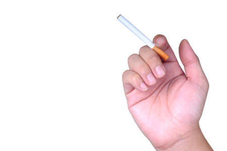 A hand holding a cigarette on isolated white background