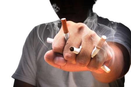 Een man vuist vol met sigaretten met een witte achtergrond Stockfoto