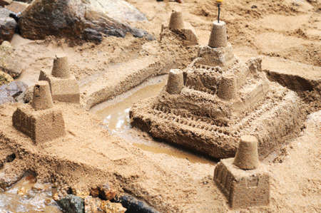 beautifull: Beautifull sand castle with tower near the river Stock Photo