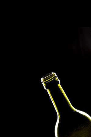 wine and dine: Exclusive lighting on bottle isolated black background Stock Photo