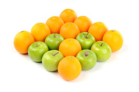 Fresh Fruit of orange and apple green in arrow shape isolated white background Stock Photo