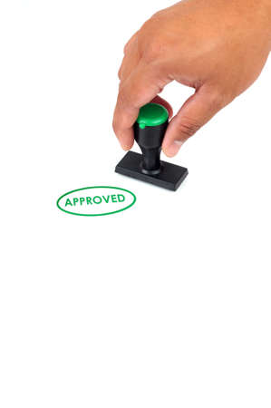 stamper: Hand hold approved Stamp in Green Color isolated white background Stock Photo