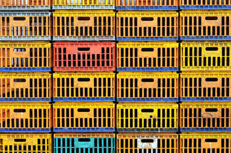 penned: Dirty chicken box in organized stack. Create colorful pattern. Stock Photo