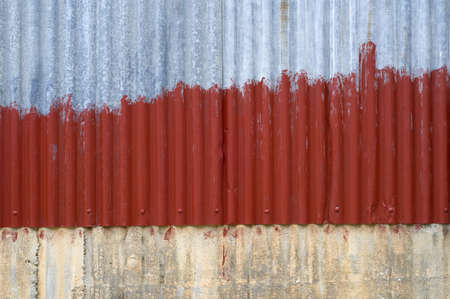 rust old zink painted with red. The zink overlap concerete wall Stock Photo - 11124377