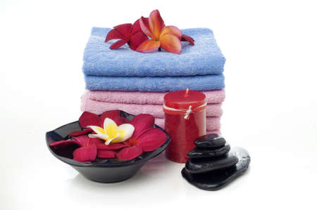 towel  spa  bathroom: Spa towel with frangipani flowers and red candle isolated white background