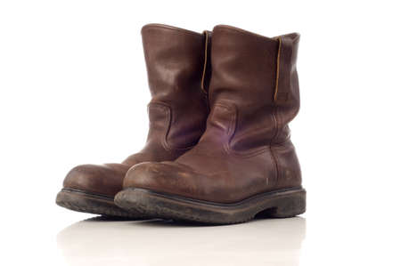 Used afety boots in brown color isolated white background photo