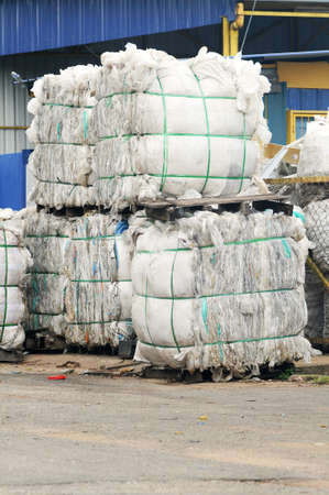garbage disposal: Stack of paper waste at recycling plant isolated recyling factory