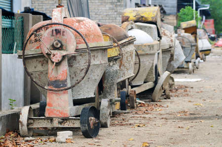 Used portable concrete mixer in row left behind the factory Stock Photo - 11116676
