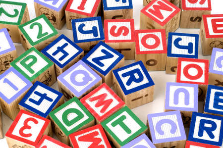 Alphabet blocks in random place isolated white background Stockfoto