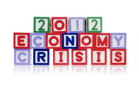 Alphabet blocks spelling 2012 Economy Crisis isolated white background Stock Photo - 11820019
