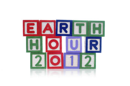 Alphabet blocks spelling Earth Hour 2012 isolated white background Stock Photo - 11820014