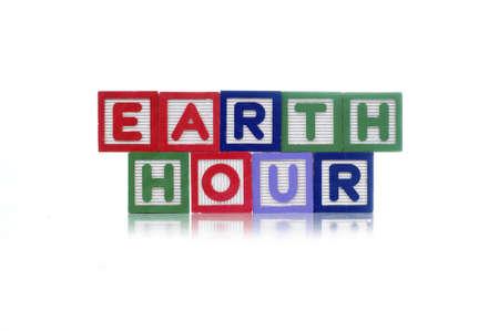 Alphabet blocks spelling Earth Hour isolated white background Stock Photo - 11819964