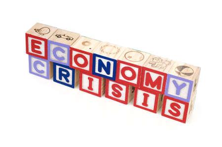 Alphabet blocks spelling Economy Crisis isolated white background Stock Photo - 11820012