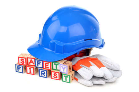 Alphabet blocks spelling Safety First with safety helmet and glove isolated white background Stock Photo - 11820011