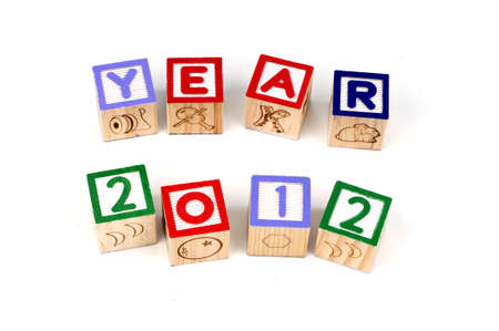 Alphabet blocks spelling Year 2012 isolated white background photo