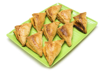 puff pastry: Chicken curry puff on green plate isolated white background