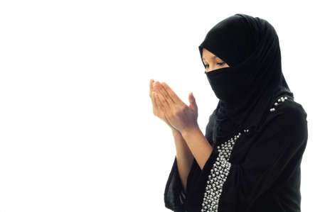 A muslim women pray looking down from side  in isolated white background