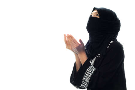 A muslim women pray looking up from side wide in isolated white background photo