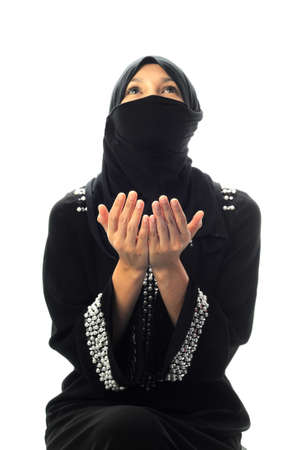 A muslim women pray in isolated white background photo