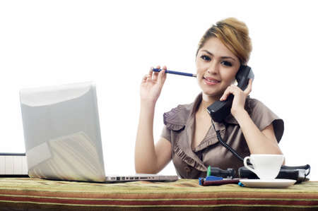 Beautiful young asian business woman talking to phone isolate white background Stock Photo
