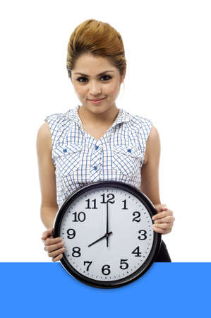 keeping: Beautiful young asian woman hold a clock show time at eight o clock isolated white background Stock Photo