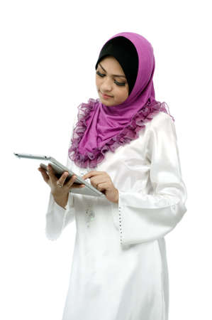 Beautiful young muslim woman messaging on mobile tab isolated white background