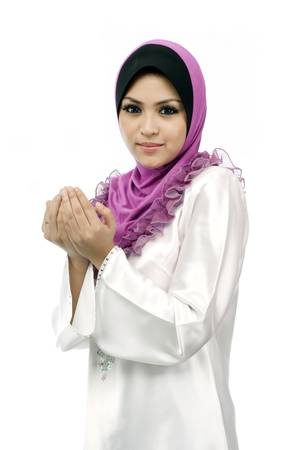 Beautiful young muslim woman pray from side view looking to front isolated white background Stock Photo