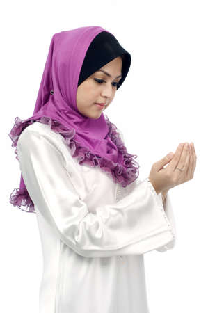 Beautiful young muslim woman pray from side view isolated white background Stockfoto