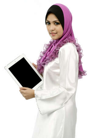 Beautiful young muslim woman showing  mobile tab screen isolated white background