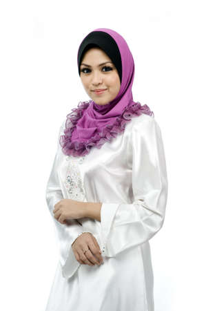 Beautiful young muslim woman with warm welcome smile isolated white background Stockfoto
