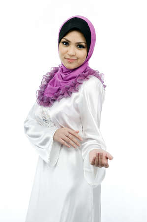 Beautiful young muslim woman with warm welcome smile and one hand open isolated white background