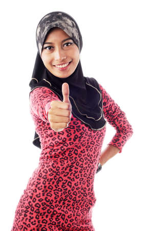 Beautiful young muslim women shows thumbs in smile isolated white background Stock Photo