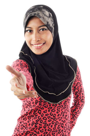 Beautiful young muslim women smile while extend her hand isolated white background