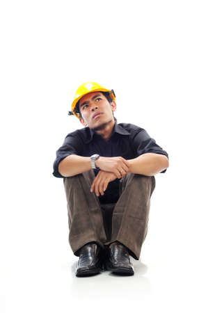 Depressed workers sit silently and looking up think isolated white background Stock Photo