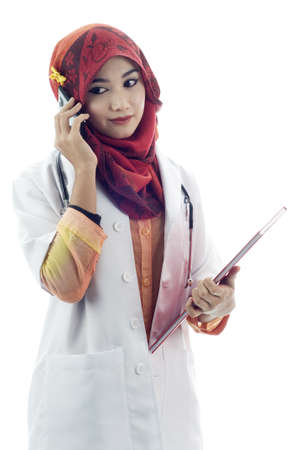 Muslim lady doctor talking to mobile phone isolated white background