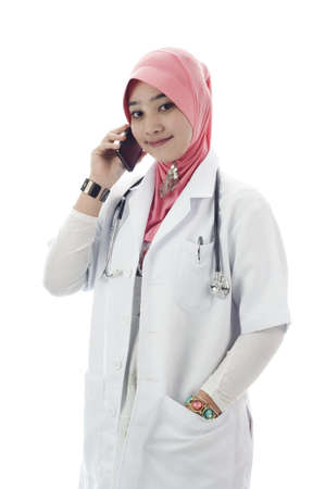 Young muslim lady doctor talk on mobile phone isolated white background photo