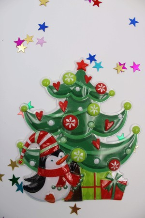 Illustration of Christmas tree with colorful ornaments and gift