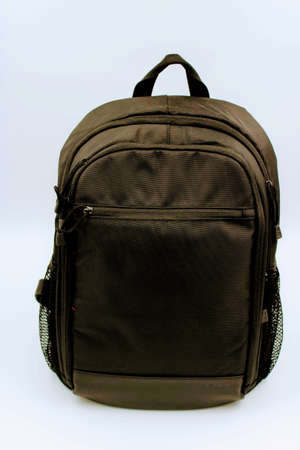 Black travel backpack with pockets for photo utensils Stock Photo