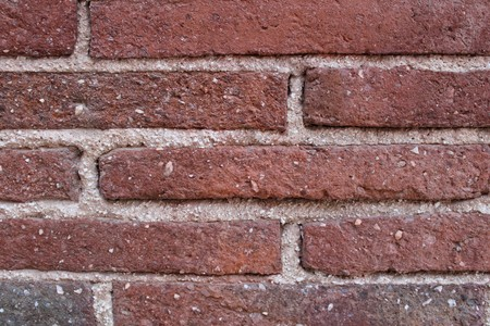 Rustic red brick wall glued with cement Stock Photo
