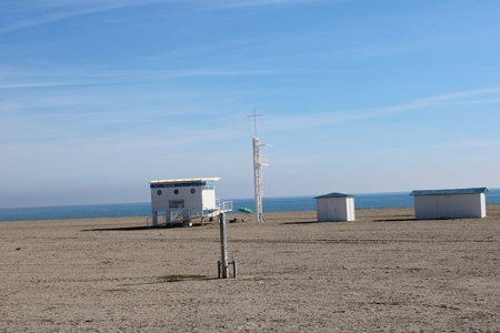 Lifeguard booth on beach with shower for feet and booth to change Stok Fotoğraf